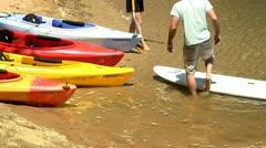 Setting up paddle board Scorton Creek Sandwich Cape Cod Stock Footage