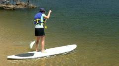 Paddle board Scorton Creek Sandwich Cape Cod Stock Footage