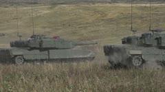 Military, leopard 2A4 tank firing main gun from back of tank, dust kicks off Stock Footage
