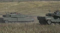Military, leopard 2A4 tank firing main gun in line Stock Footage