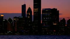 Illuminated panorama Chicago sunset at dusk, USA Stock Footage