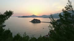 Sunset and Sveti Stefan sea islet (Montenegro) Stock Footage