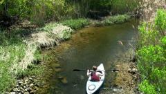 Upstream female kayaker Scorton Creek Sandwich Cape Cod Stock Footage