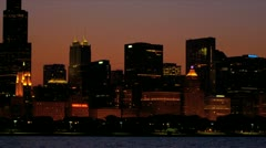 Illuminated Chicago City sunset view at dusk, USA - stock footage