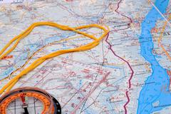 Fragment of a map with compass Stock Photos