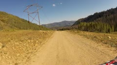 ATV on mountain road power electric transmission line HD 012 - stock footage