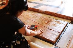 Young woman at Stone of Unction - jerusalem Stock Photos