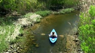 Upstream male kayaker Scorton Creek Sandwich Cape Cod Stock Footage