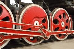 big old locomotive wheels - stock photo