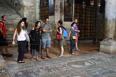 Mosaic and visitors  at the Church Holy Sepulcher Jerusalem Stock Photos