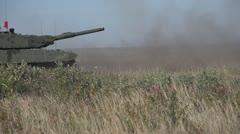 Military, slo-mo (true slow motion 240 FPS) Leopard 2A4 tank firing main gun Stock Footage