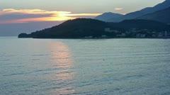 Pink sunset and coastline (Albania) Stock Footage