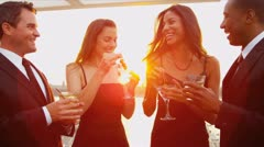 Multi ethnic couples have fun at city cocktail party dressed in black   Stock Footage