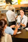 man paying bill at cafe using card - stock photo