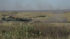 Military, leopard 2A4 tank firing main gun profile medium Stock Footage