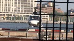 Helicopter lending in Manhattan heliport Stock Footage