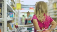Stock Video Footage of Adorable girl sit in sopping cart in supermarket