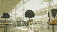 Empty tables on food zone in mall Stock Footage