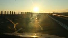 Car Runs on Highway at Sunrise Stock Footage