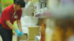 Stock Video Footage of Customers select porridges and flours on shelves in supermarket