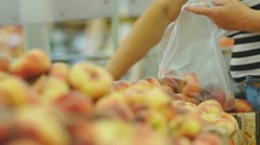 Stock Video Footage of Customers select peaches in supermarket