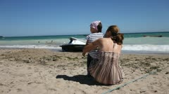 Mother and Daughter Enjoy Ocean, Sun and Beach Stock Footage
