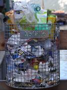 Overstuffed trashcan Stock Photos