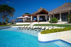 luxury summerhouse with swimming pool on beach - stock photo