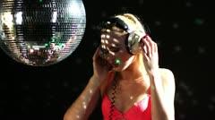 Blonde girl dances discoball Stock Footage
