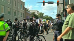 Police watch protesters in charlotte democratic national convention 2012 Stock Footage