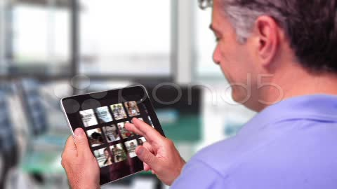 After Effects Project - Pond5 Businessman Browsing iPad Gallery 11988847