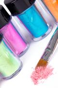 tubes with professional pigment and make-up brush - stock photo