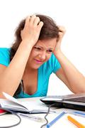 depressed student holding her head - stock photo