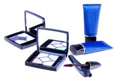 Eyeshadows palettes,mascara stick with pack and  blue tubes with cream Stock Photos