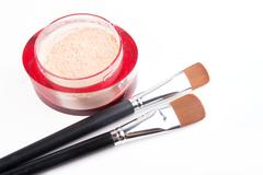 two make-up brushes and red box with powder isolated on white - stock photo