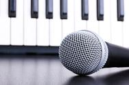 Microphone on piano keyboard background Stock Photos