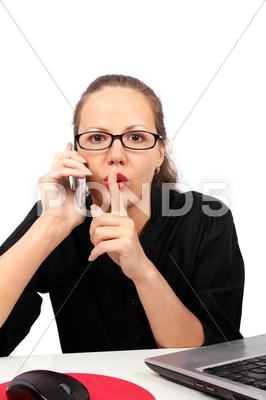 Stock photo of businesswoman making shhh gesture
