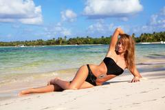 woman relaxing on caribbean beach - stock photo