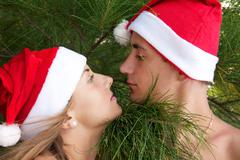 Looking couple in christmas hats Stock Photos