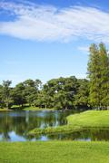 View of a lake at the golf course Stock Photos
