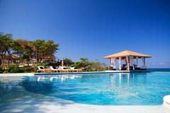 Summerhouse near luxury swimming pool Stock Photos