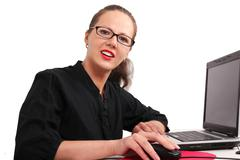 secretary in glasses in office - stock photo
