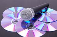Mic on cd discs Stock Photos