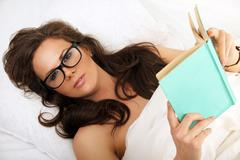 Girl in glasses with book Stock Photos