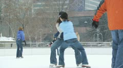 A woman and a young girl playing at an ice rink Stock Footage