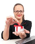 Stock Photo of surprised businesswoman with present box in hand