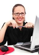 Smilling businesswoman with pen in hands Stock Photos
