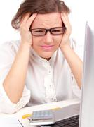 depressed businesswoman  in office - stock photo