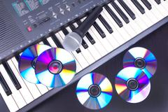 Vocal microphone,cd discs and electronic keyboard Stock Photos