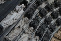 Statues on the front of the Cathedral in Cologne, Germany - stock photo